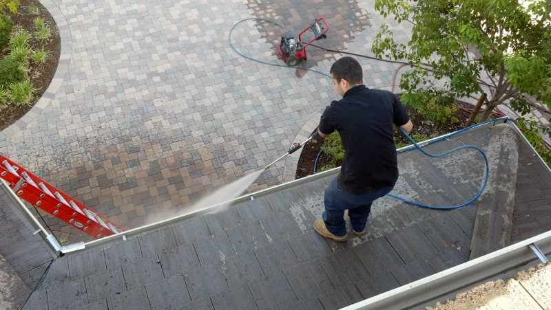 pressure washing a house before painting